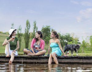 Girls on dock with Scruffy